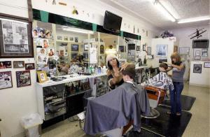 Rino's  Barber Shop that he owned for 30 years at two different Main Street locations. The photo depicts the last location where Rino conducted business prior to his death in 2008. The existed as a barber shop on Main Street in two different locations under previous owners to 1947.